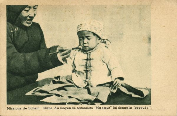 china, Sister feeds Young Chinese Boy with Sticks (1930s) Mission