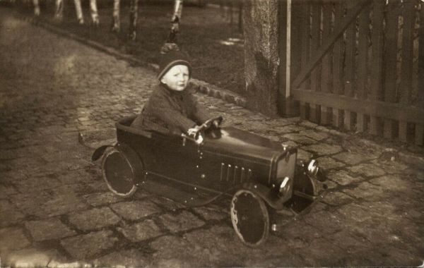 Young Boy in Tin Toy Car, Blech Auto, Blechspielzeug (1931) RPPC
